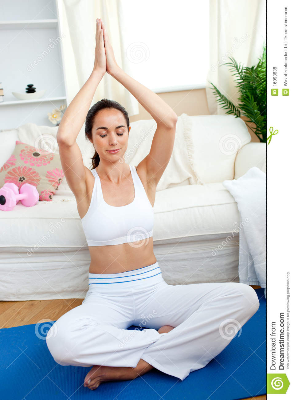 Bright woman practicing yoga in her living room royalty for Living room yoga timetable
