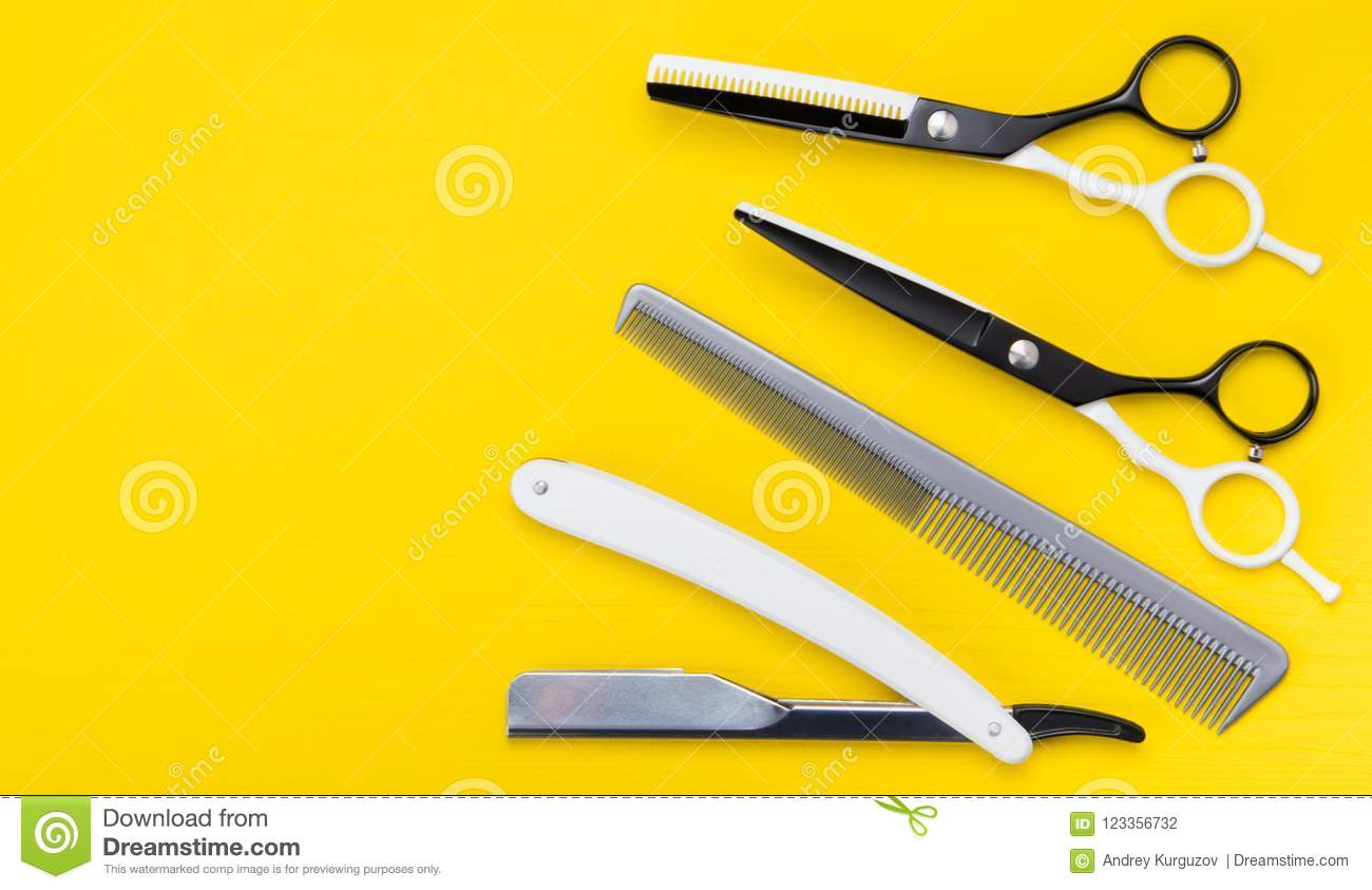 Bright Yellow Background. A Set Of Items For Cutting Hair