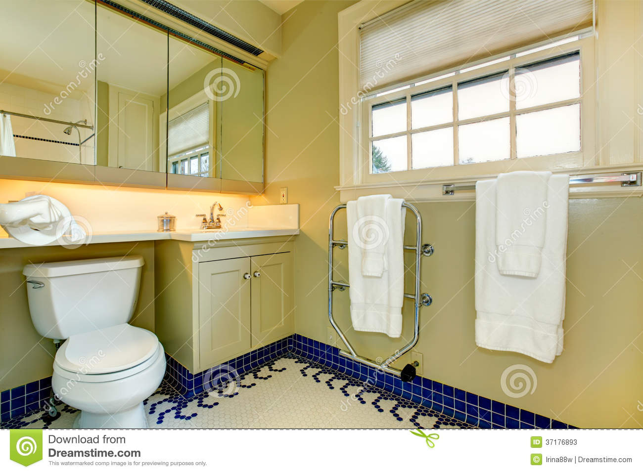 Bright Yellow Bathroom With Blue Tile Floor