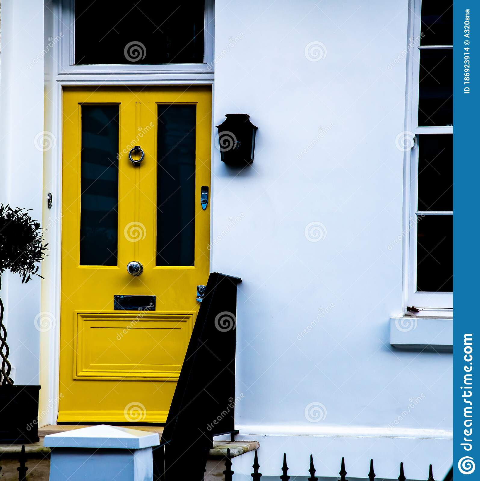 A Bright Yellow Door On A White Building Stock Photo Image Of Yellow Brilliant 186923914