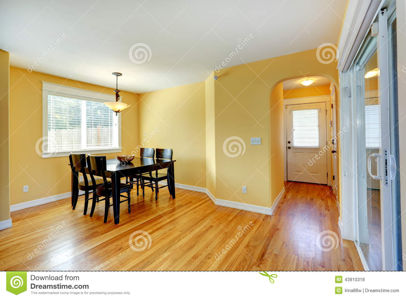 Bright Yellow House Interior Dining Area With Wooden Table And Royalty Free Stock Photos