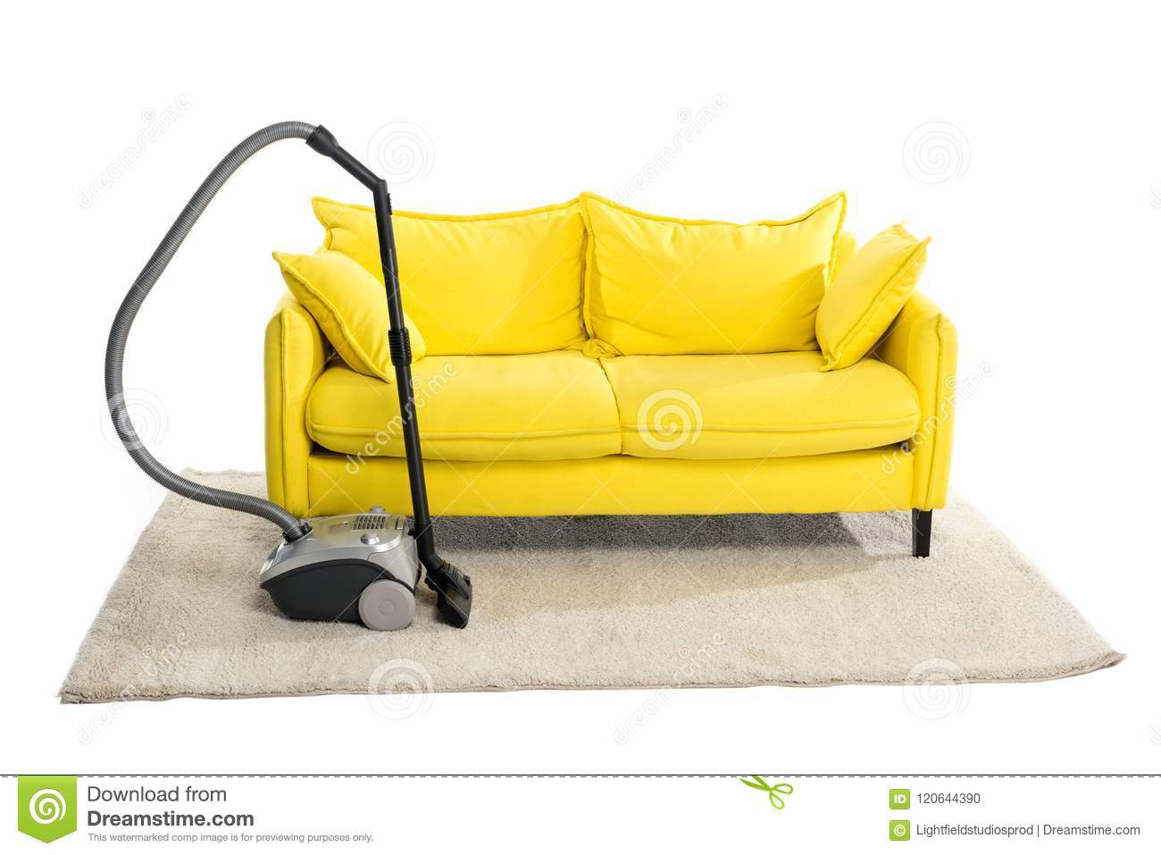 Bright Yellow Sofa And Vacuum Cleaner On Carpet Stock Photo Image
