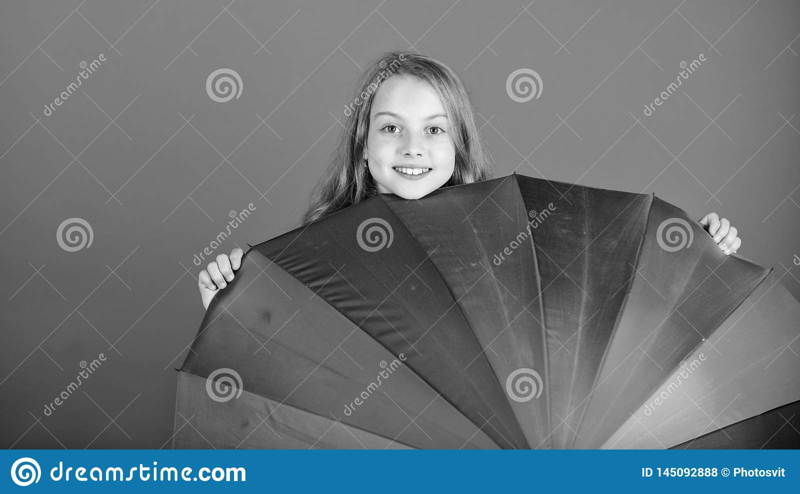 Brighten up life. Kid peek out colorful rainbow umbrella. Color your life. Girl cheerful hide behind umbrella. Colorful