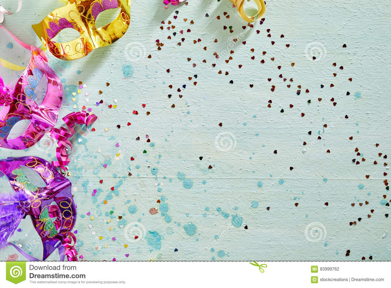 Brightly Colored Carnival Or Mardi Gras Border With Metallic Foil Eye Masks Decorated Feathers