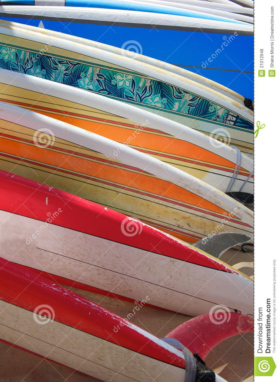 Brightly Colored Surfboards Laying on the Sand
