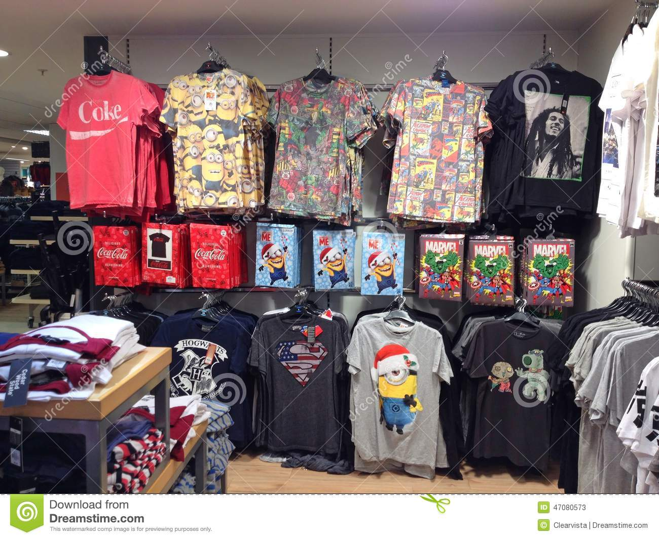 Brightly colored t shirts on racks in a store editorial for T shirts store online