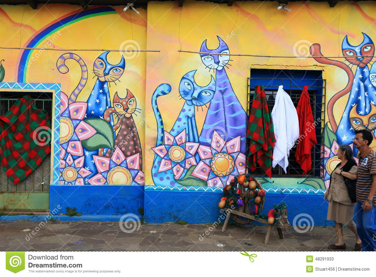 Brightly coloured mural ataco el salvador editorial for Average cost of mural painting