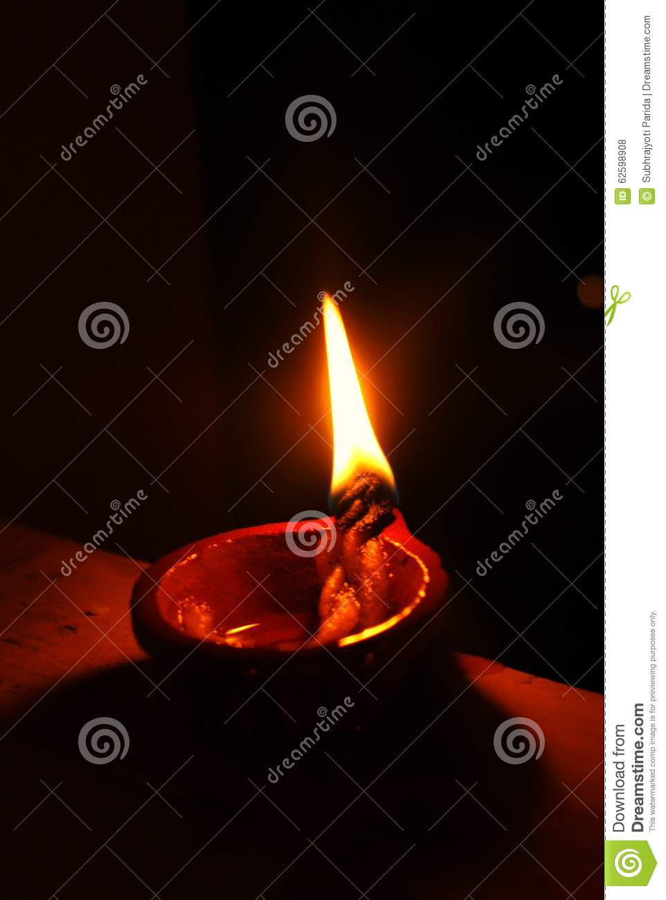 Brightly Lit Earthen Lamp During Diwali Stock Photo - Image of flame ... for Earthen Lamp Clipart  83fiz