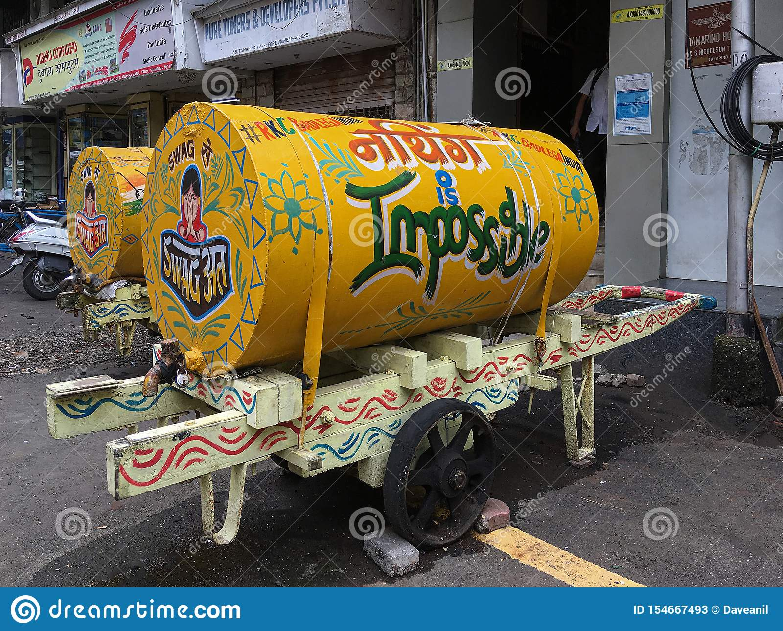 Brightly painted hand cart of water deliver water to homes & offices Fort Mumbai