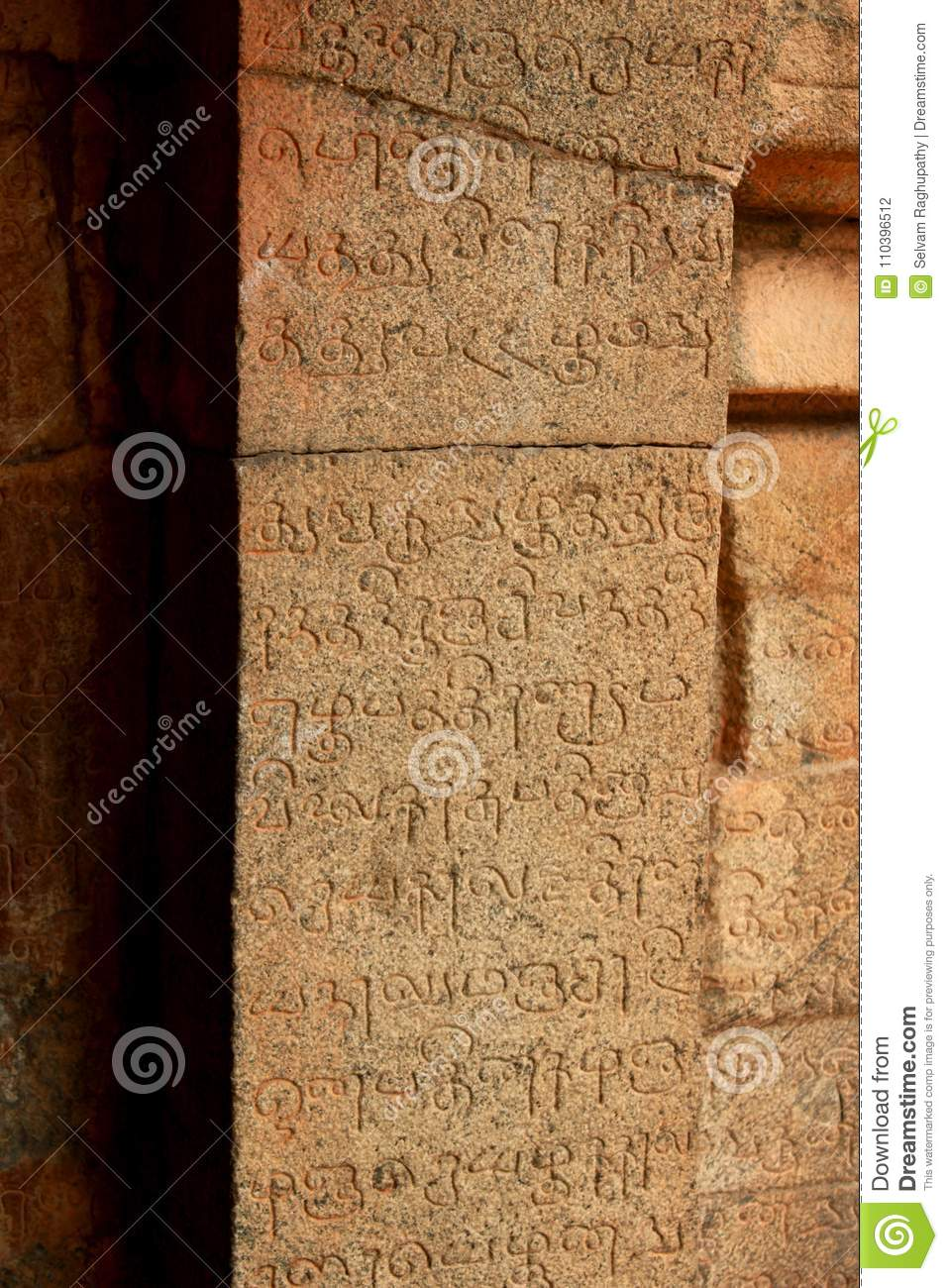 Tamil and Sanskrit inscriptions on a pillar from the 11th century.