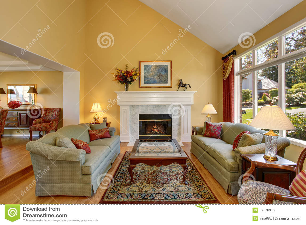 Brilliant Living Room With Green Sofas, And Yellow Walls. Stock ...