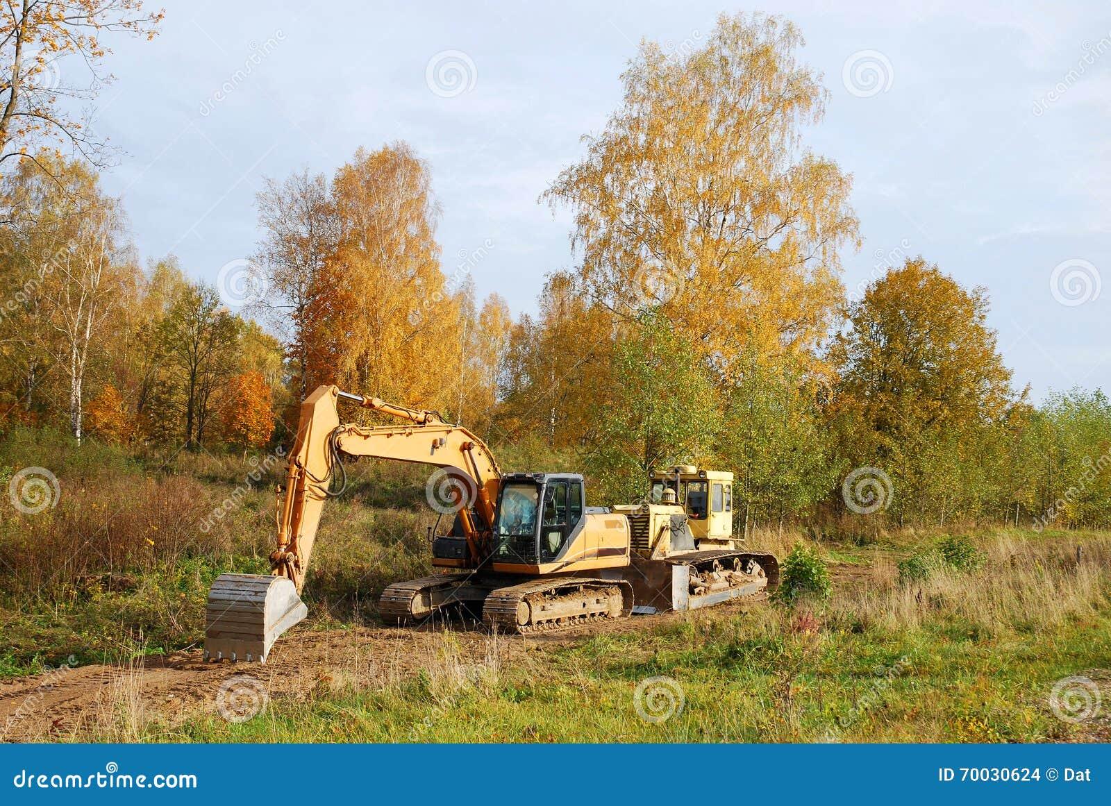Brinquedo da máquina escavadora e da escavadora com trabalho da palavra