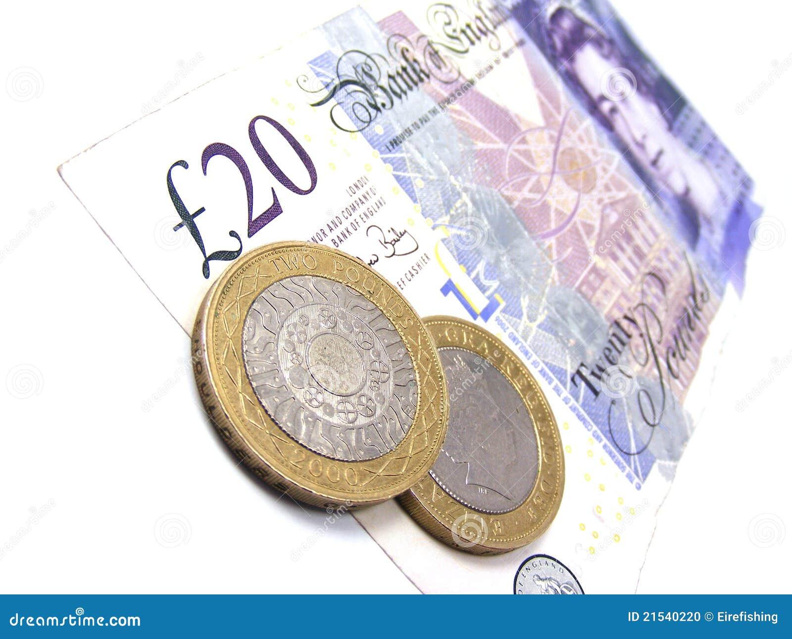 Briten 20 Pfund Anmerkung Mit 2 Pfund Münzen Redaktionelles Bild