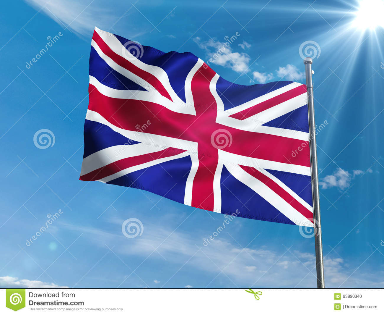 British flag waving in blue sky with sun