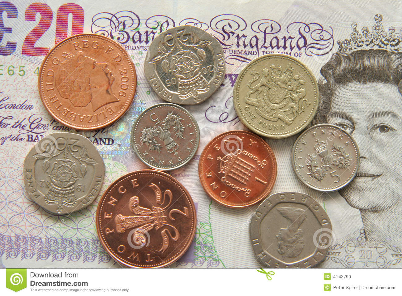 selection of modern British coins along with a 20 pound note.