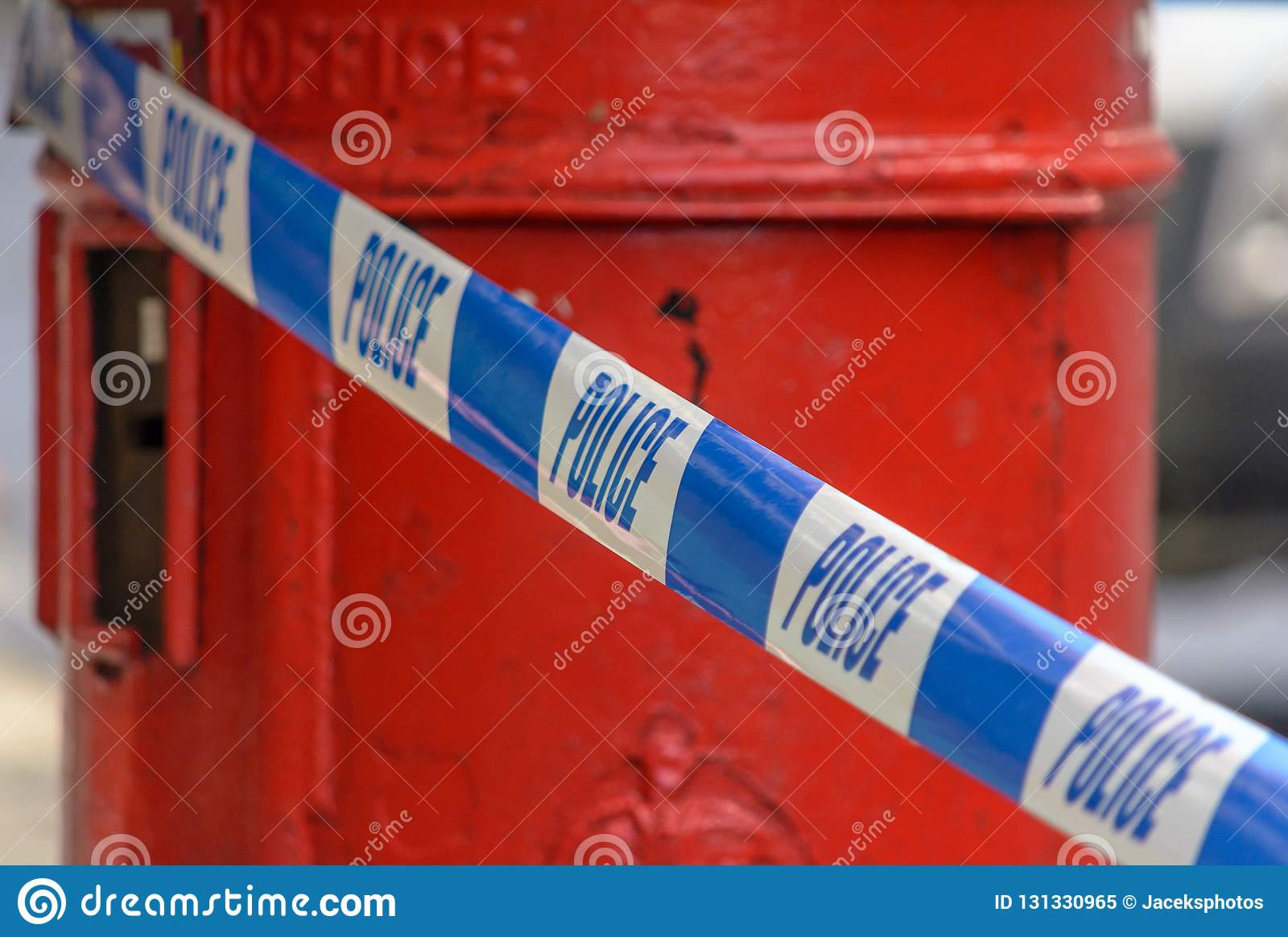 British Police Tape In Front Of Red Post Box