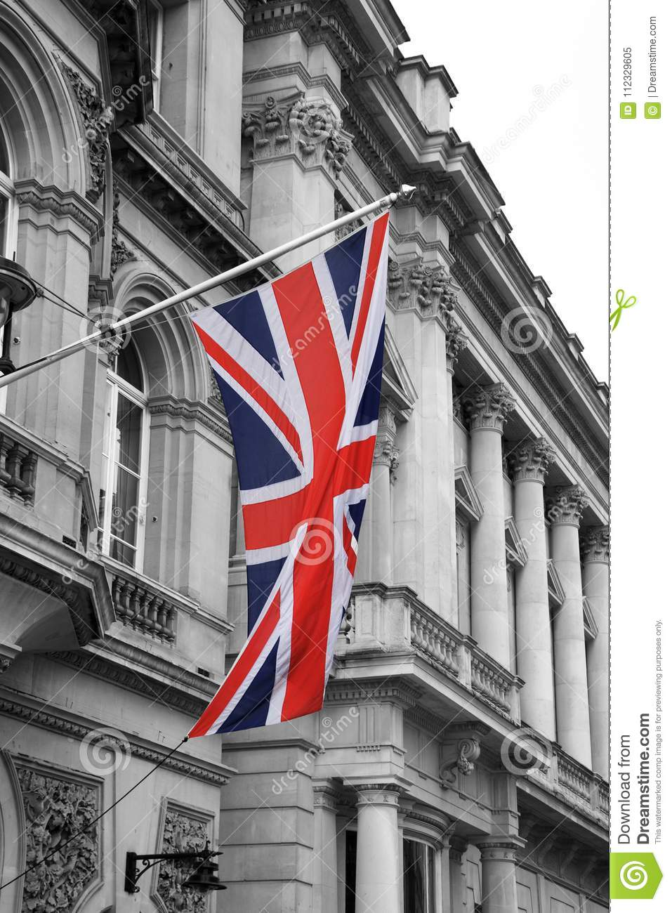 Download A British Union Jack Flag On Pole With Black And White Buildings Stock Image
