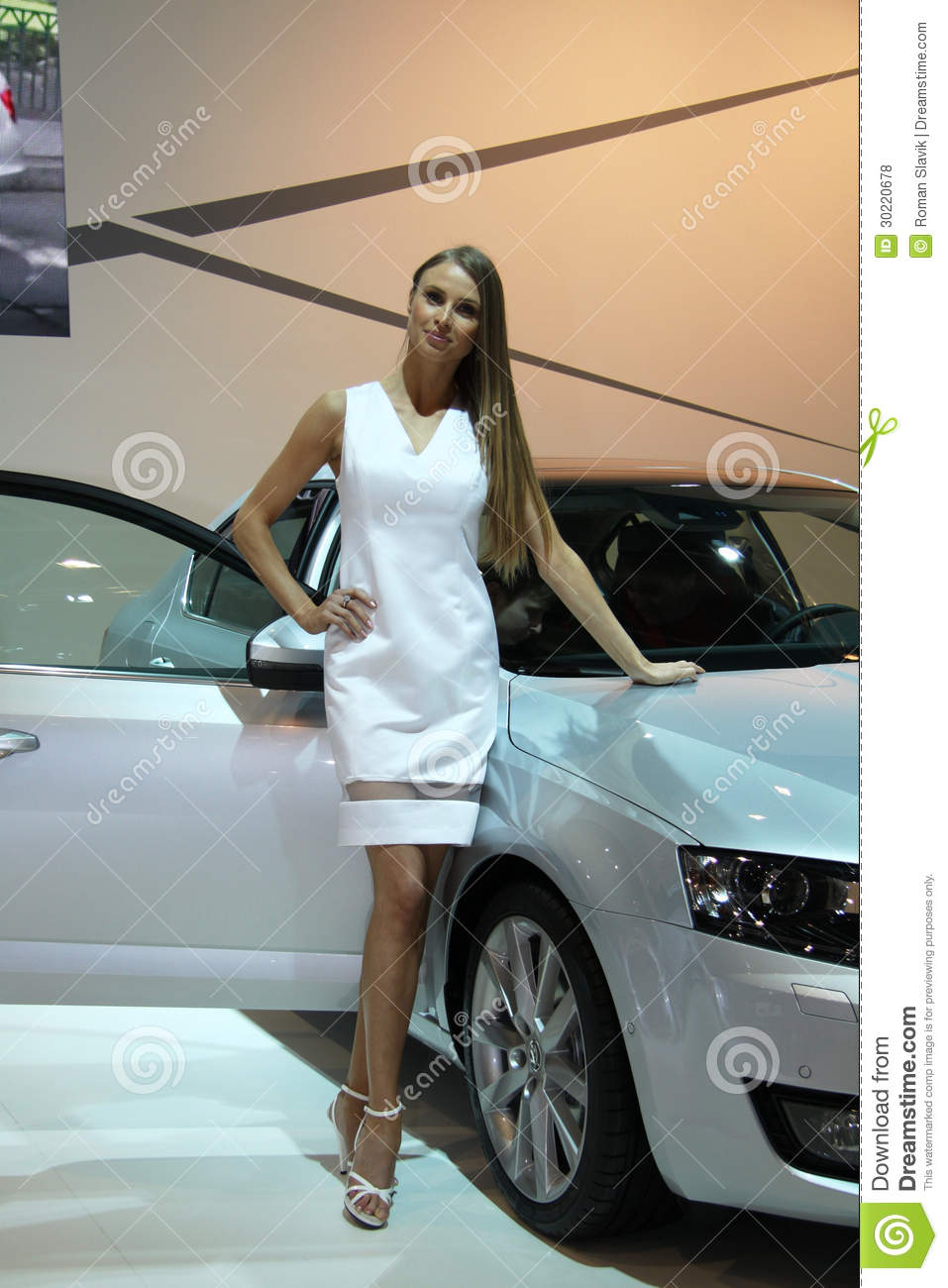 Hostess with skoda octavia 3rd generation on display at for 3rd international salon of photography smederevo 2013