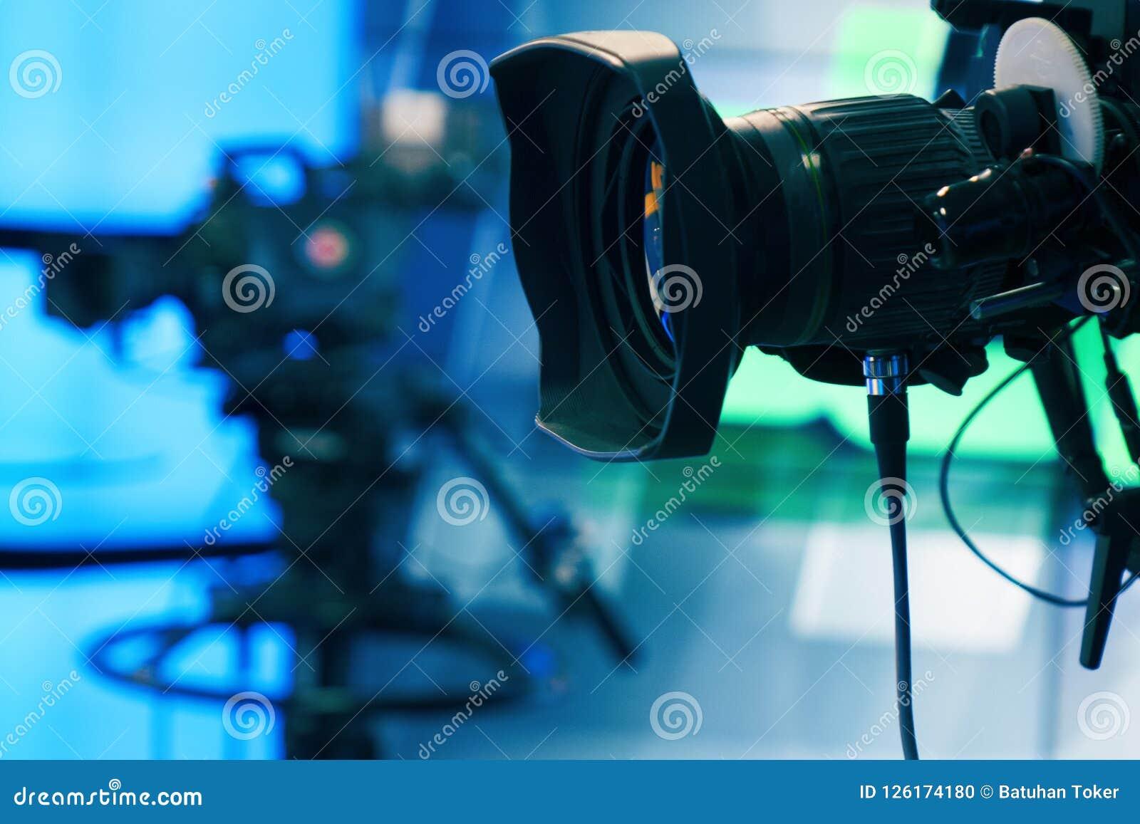Broadcast television studio camera and crane camera in news studio room