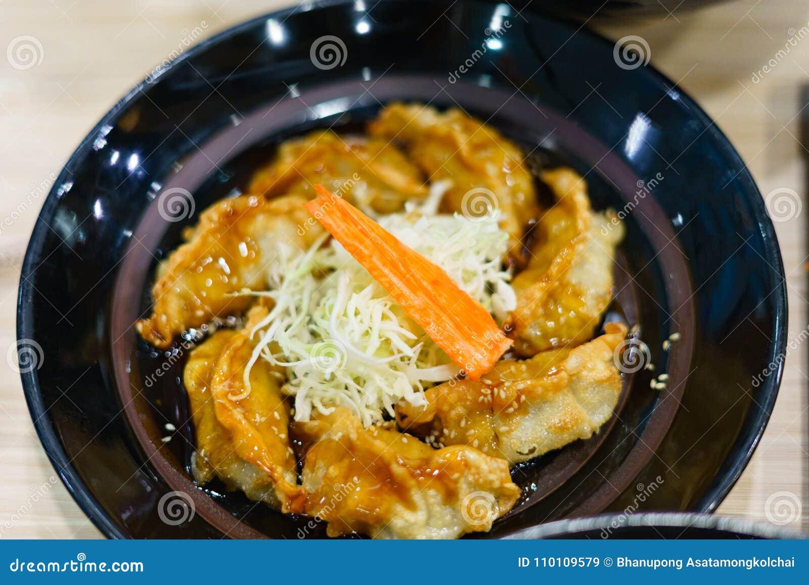Broiled Gyoza in black dish