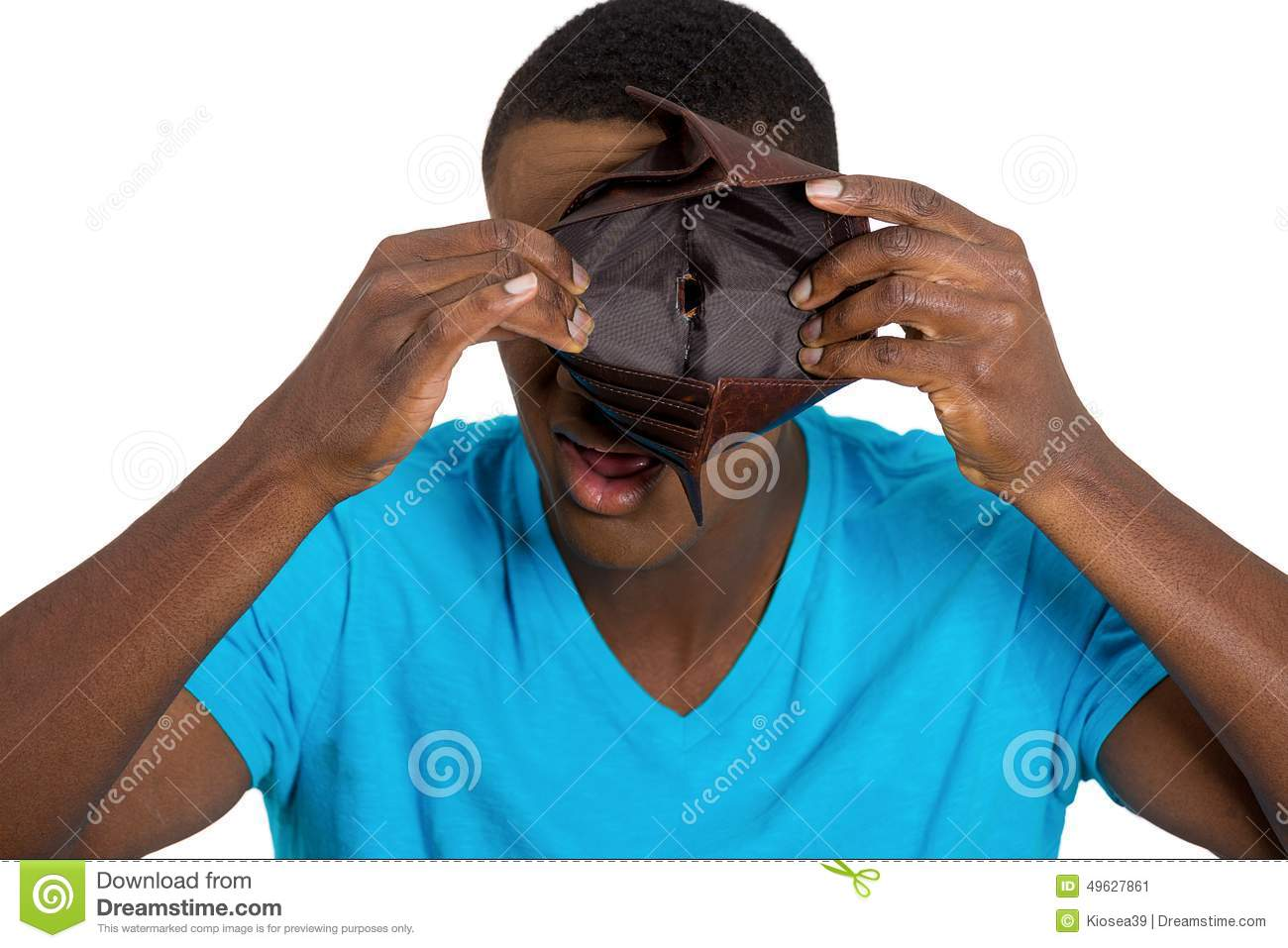 Broke young man showing empty wallet