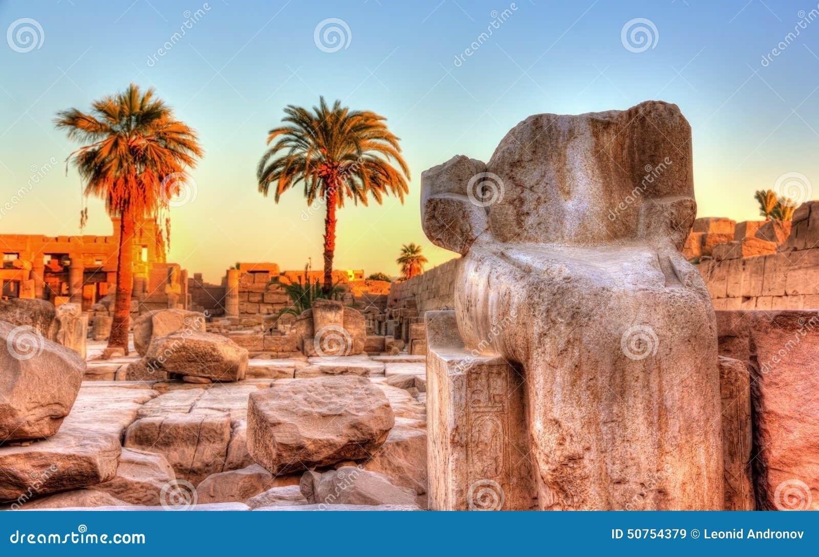 Broken ancient statue at the Karnak temple - Egypt