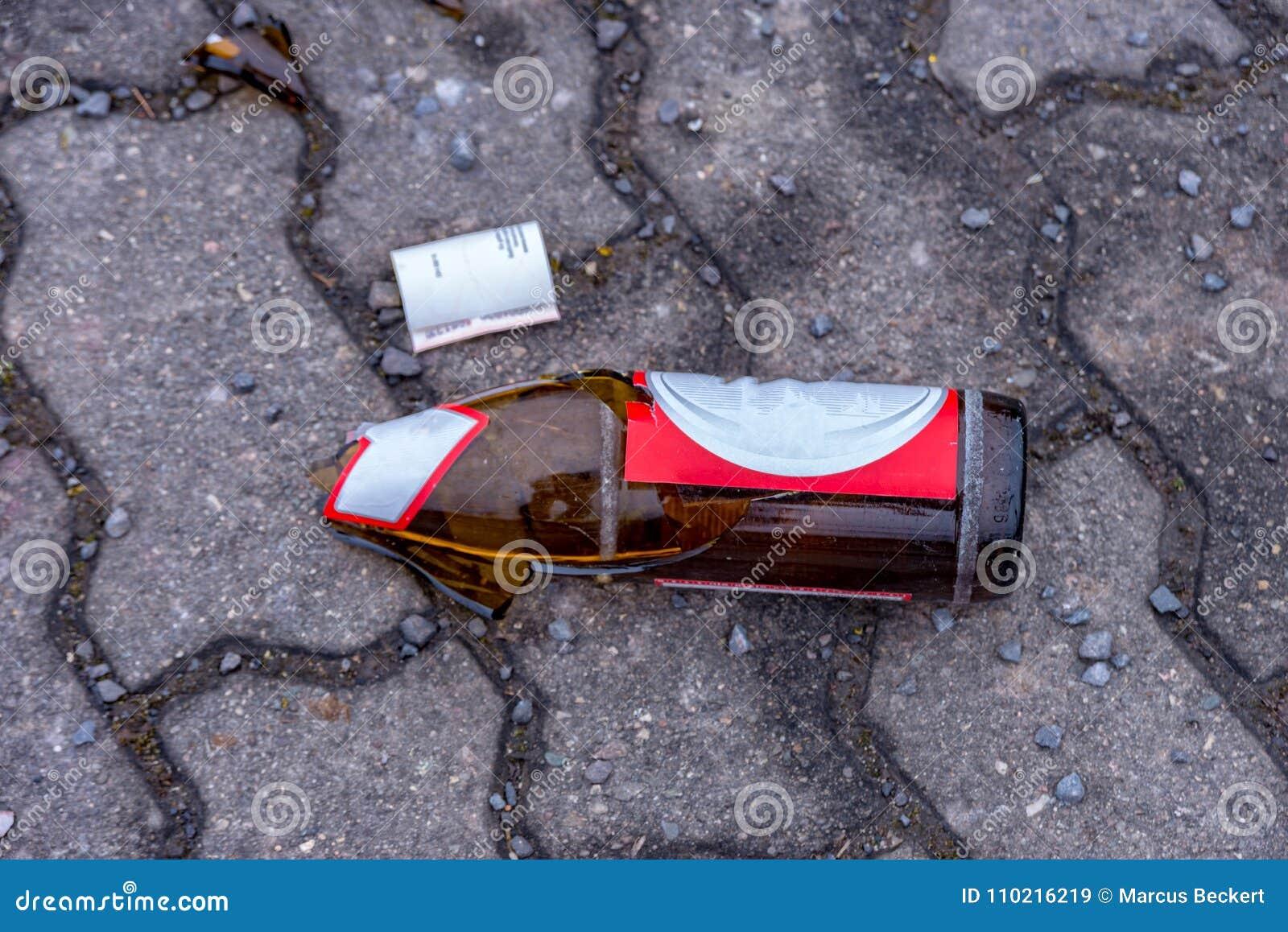 Broken beer bottles in the middle of the footpath
