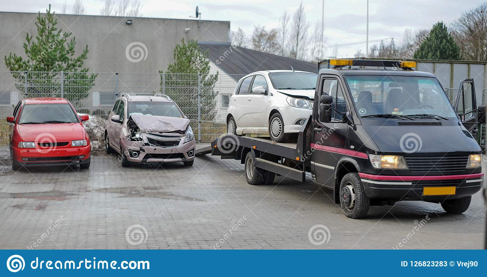 Broken Car On Tow Truck After Traffic Accident Stock Image