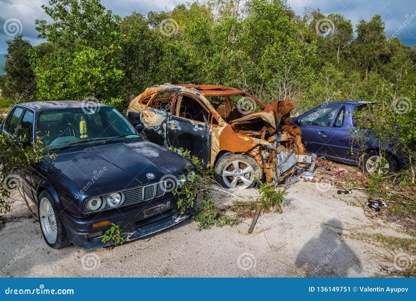 Broken Cars In A Dump In The Field On Koh Samui In Thailand