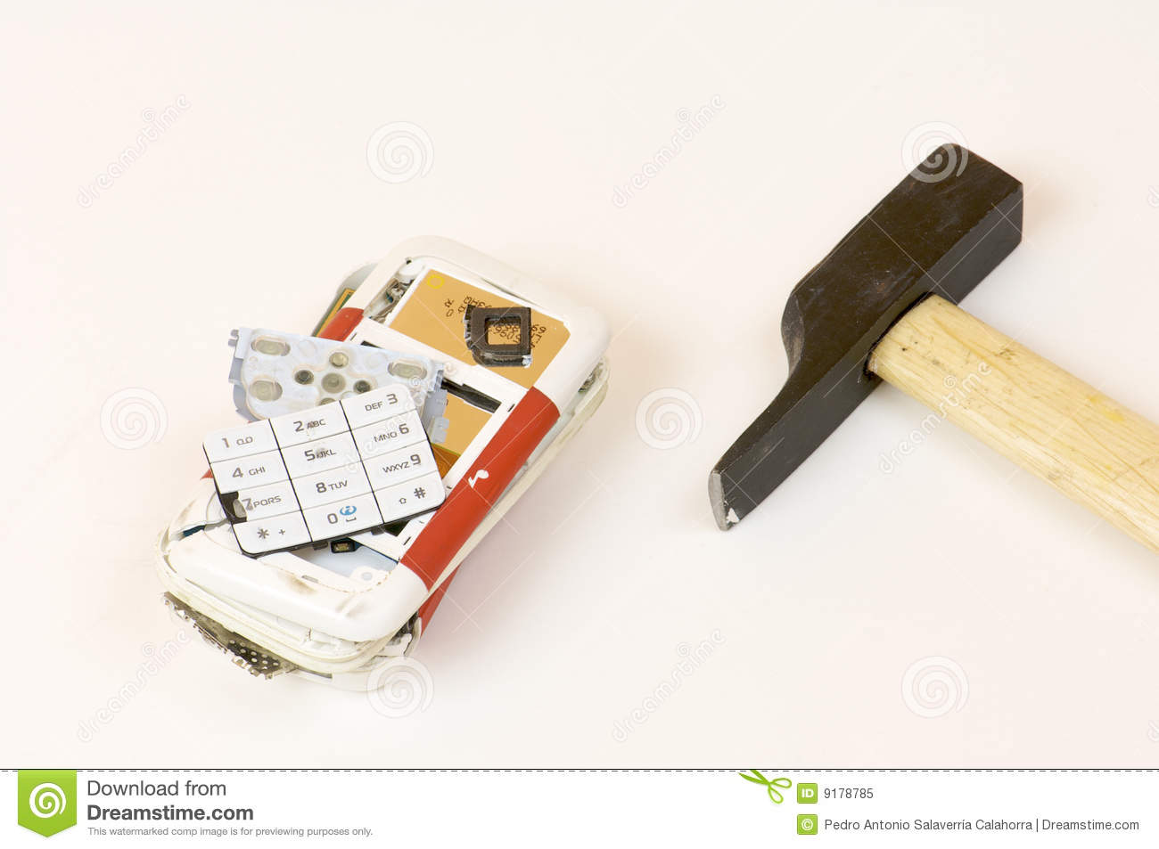 Broken cell phone and hammer