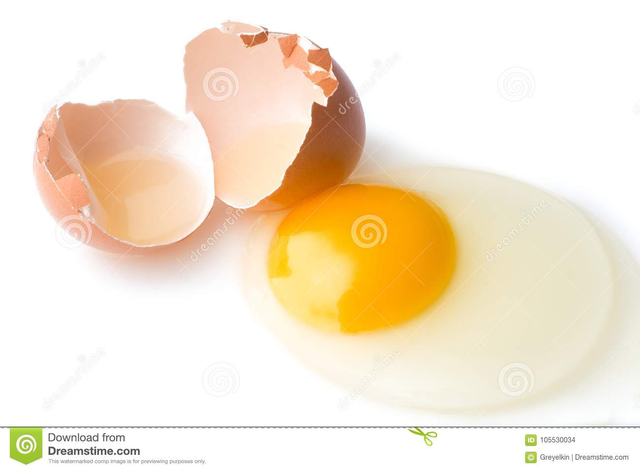 A broken chicken egg lies on a white background with a shell, yo