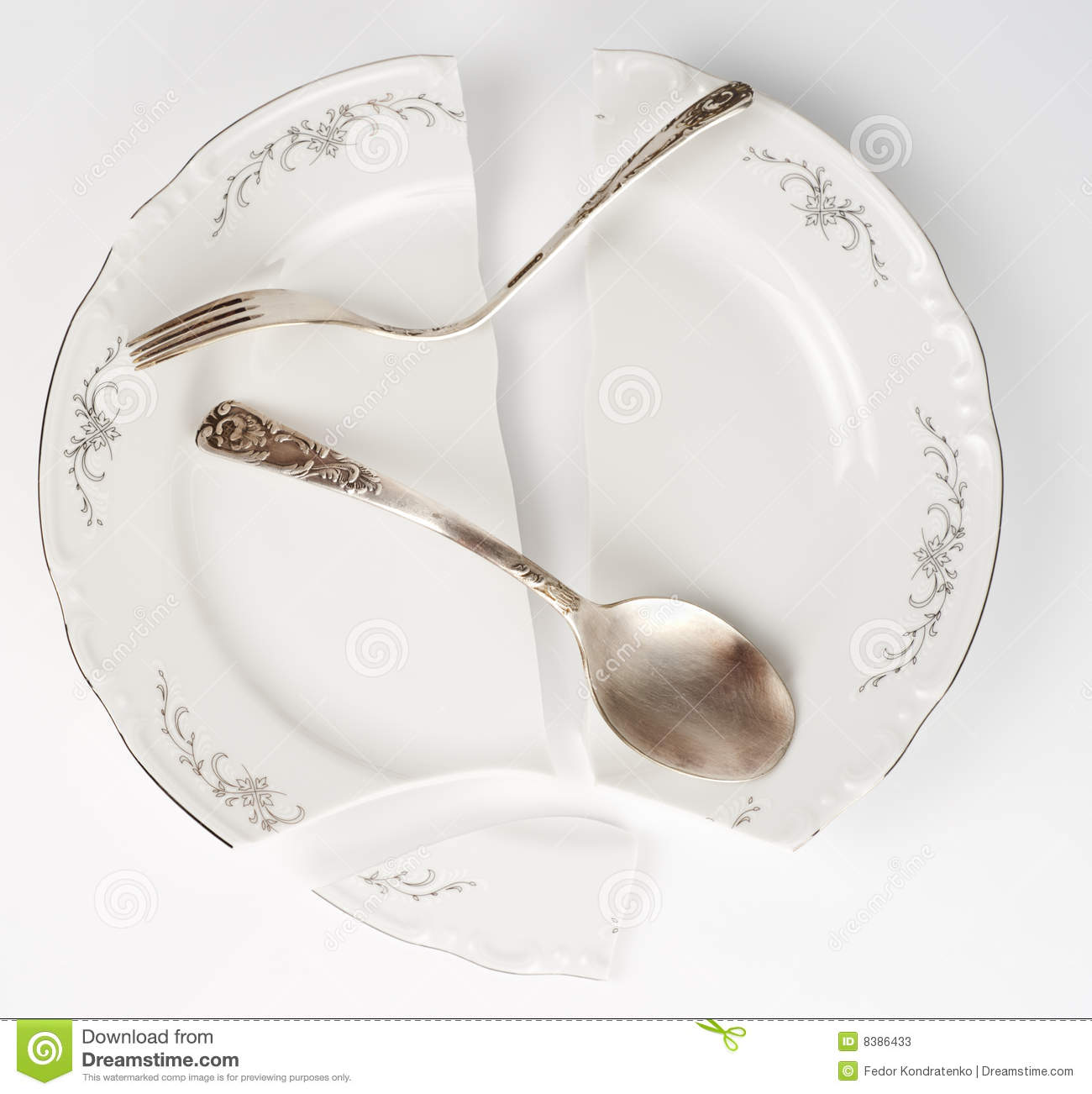 Broken China Plate And Bent Silverware Stock Photos - Image: 8386433