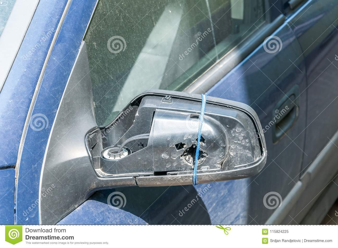 Broken And Damaged Side Mirror On The Blue Car Doors With Remaining ...
