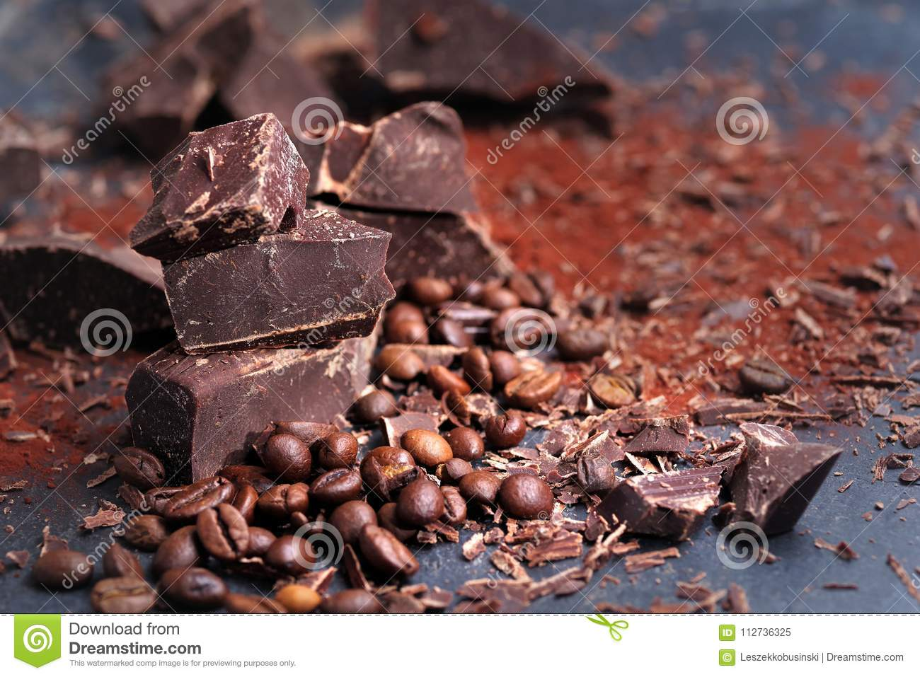 Broken dark chocolate, cocoa powder and coffee beans