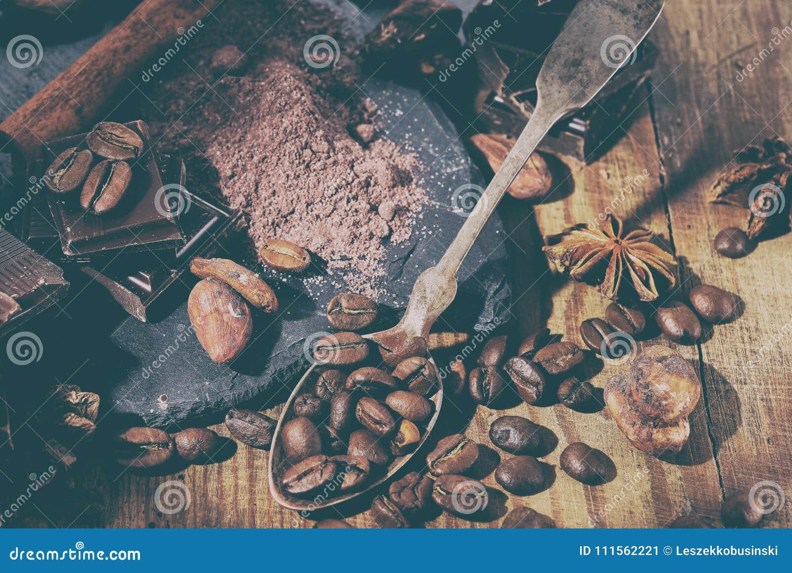 Broken dark chocolate, cocoa powder and coffee beans