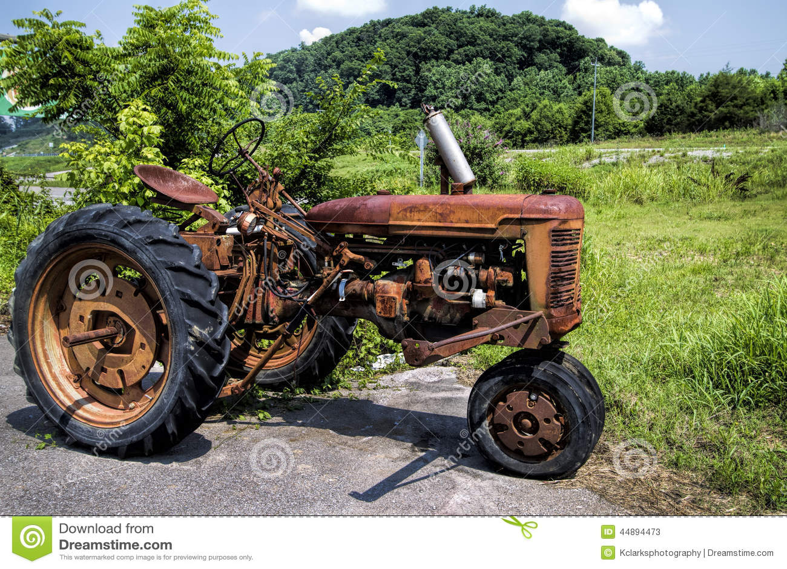 Tractor Broke Down : Broken down vintage red tractor stock photo image