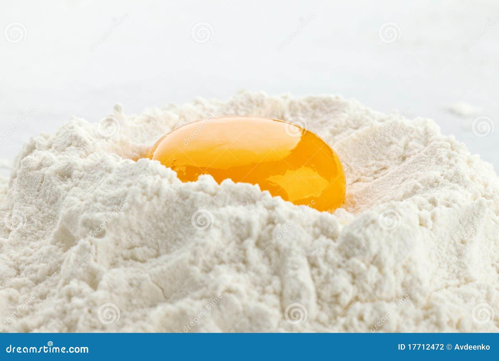 Broken egg on flour