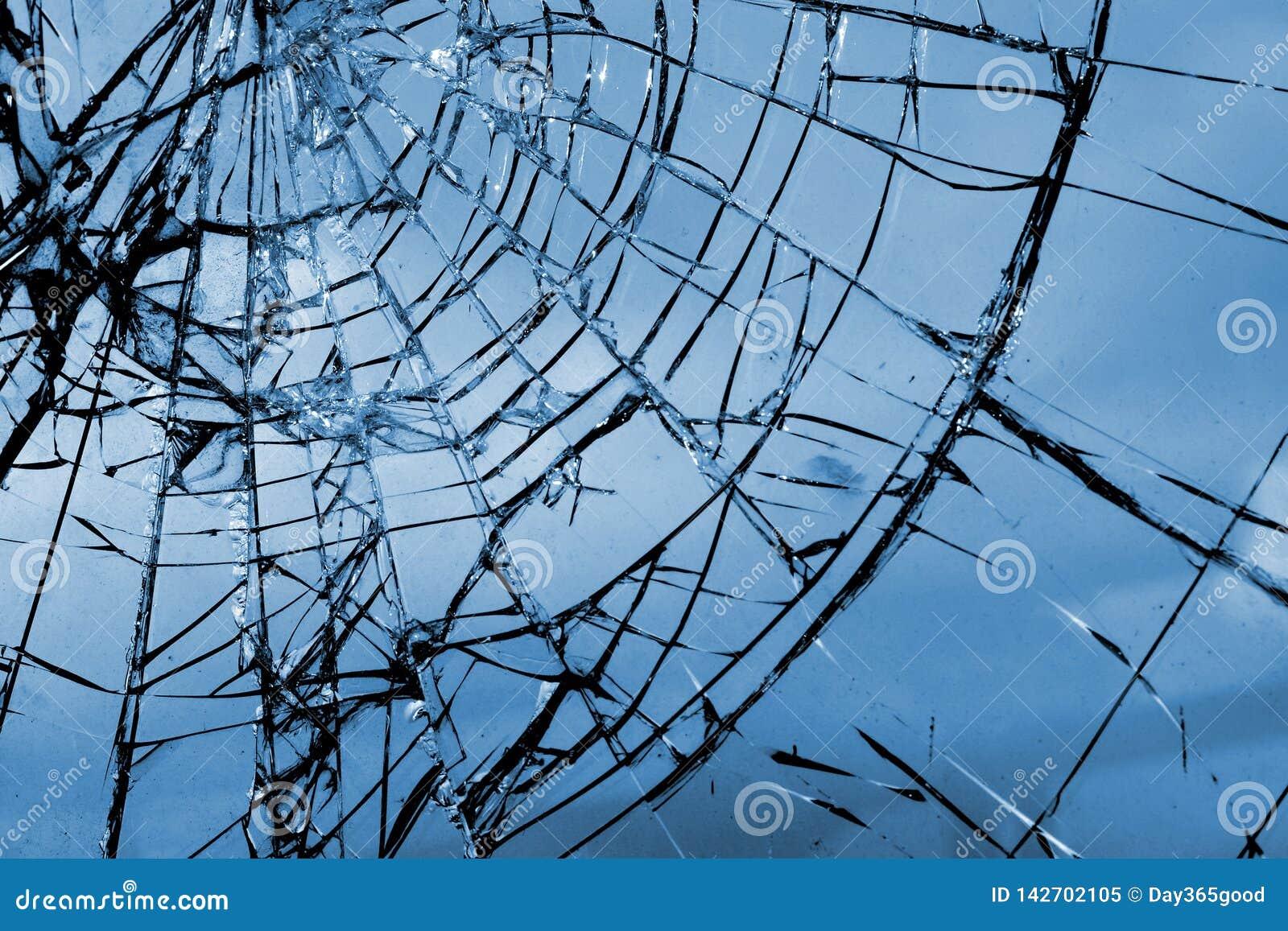 Broken glass. Grid cracks on the glass like cobwebs