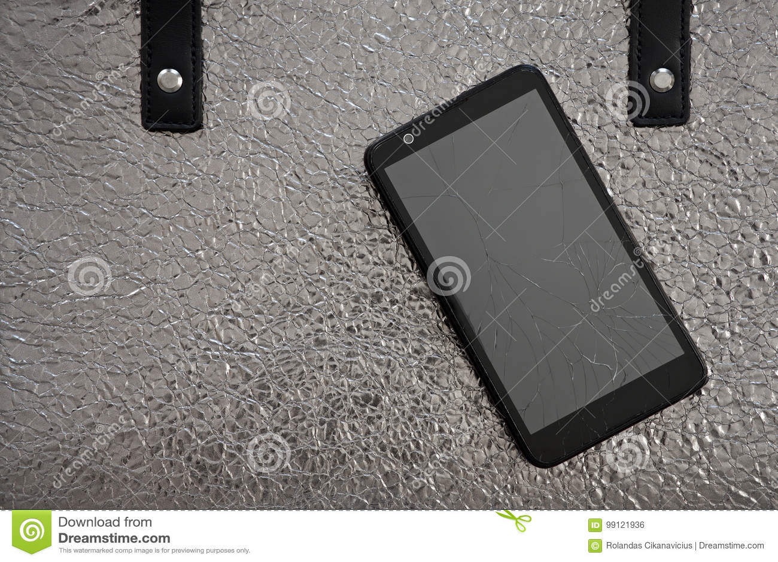 Broken glass of smart phone on leather bag