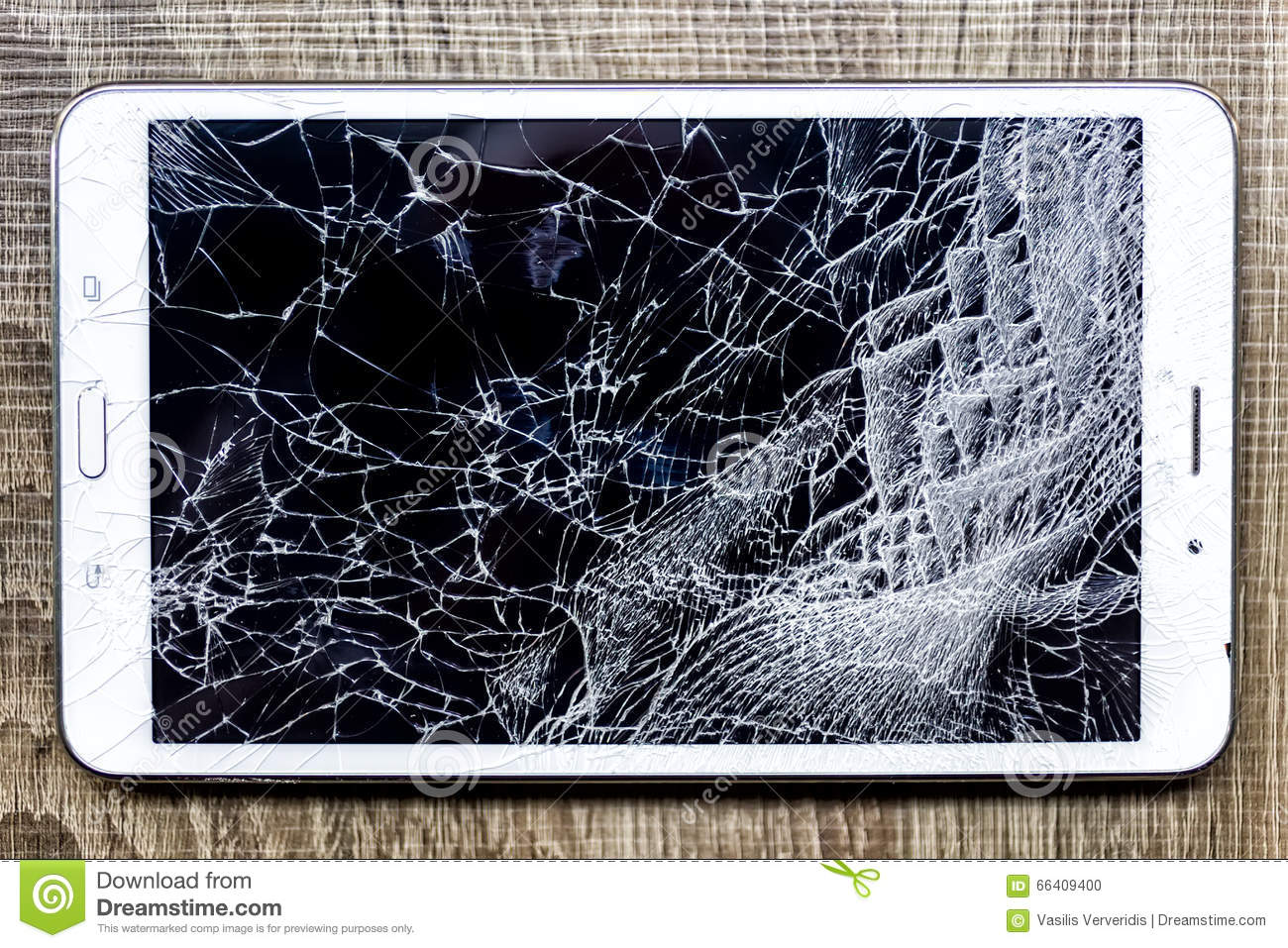 Broken glass of tablet on the grunge wood. Selective focus. Low