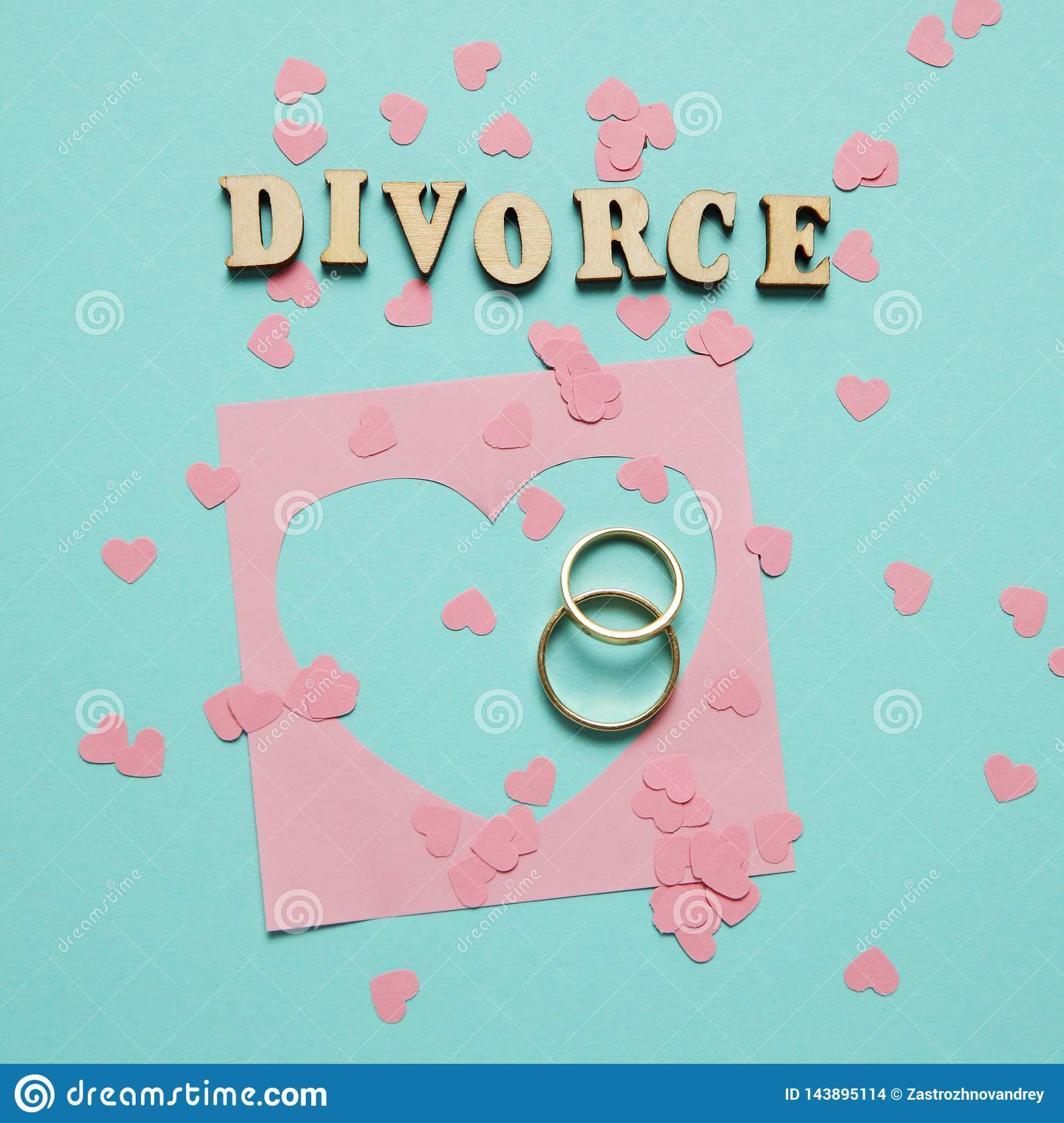 Broken heart and two gold rings. Civil family divorce, conflict