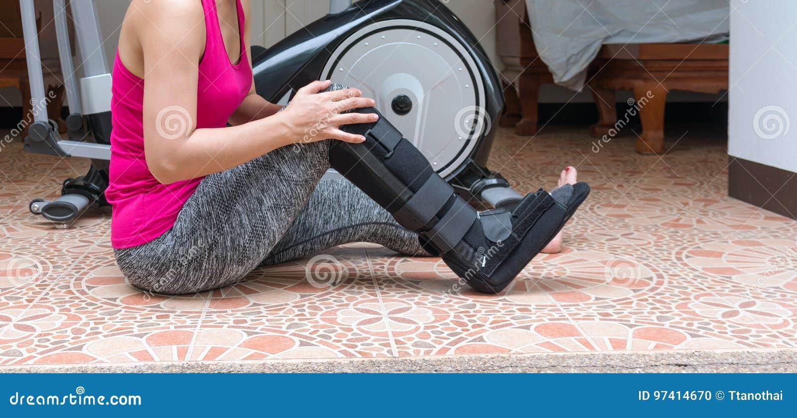 Broken Leg, Injury Woman Wearing Sportswear And Ankle