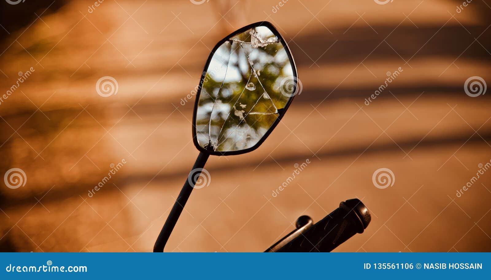 A broken mirror of a bike