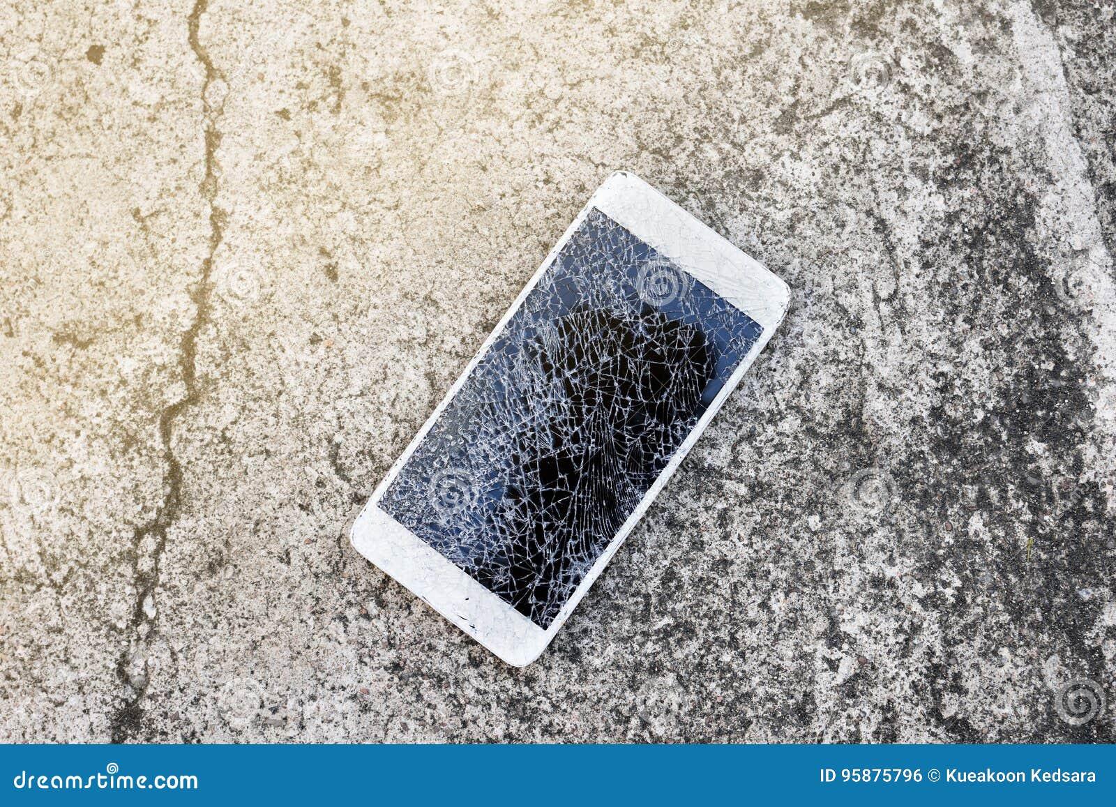 Broken mobile phone drop on cement floor