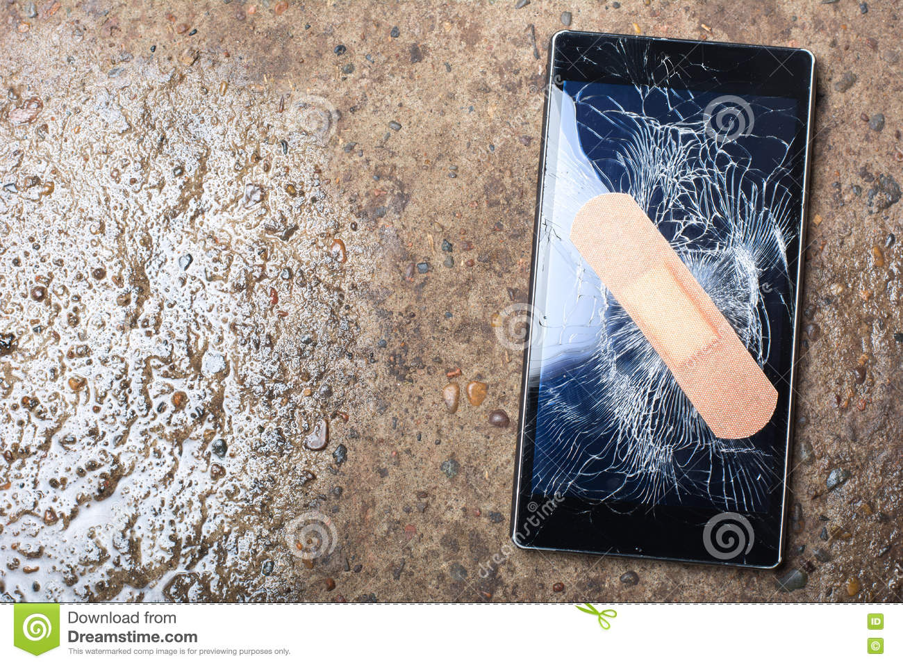 Broken Phone with cracked screen fixed with sticking plaster. Co