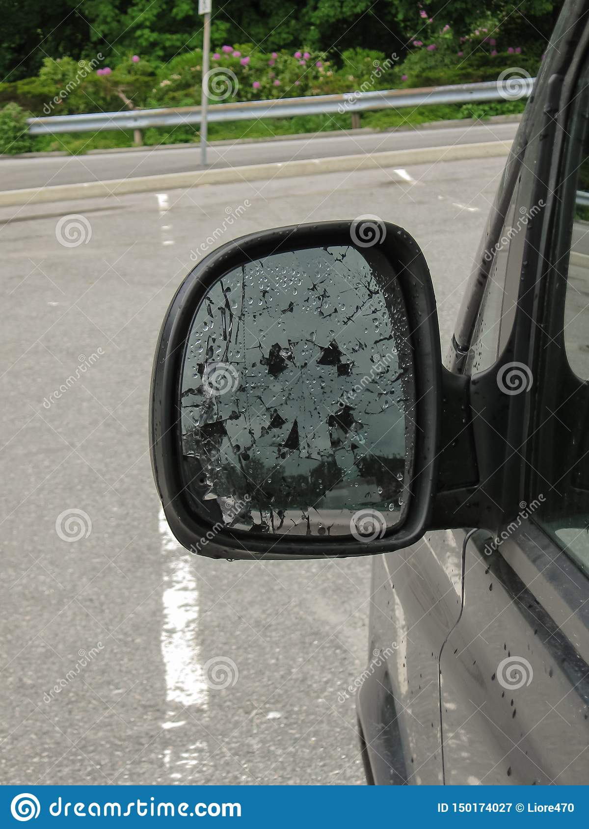 Broken side mirror car close-up. The consequences of the accident or an act of vandalism