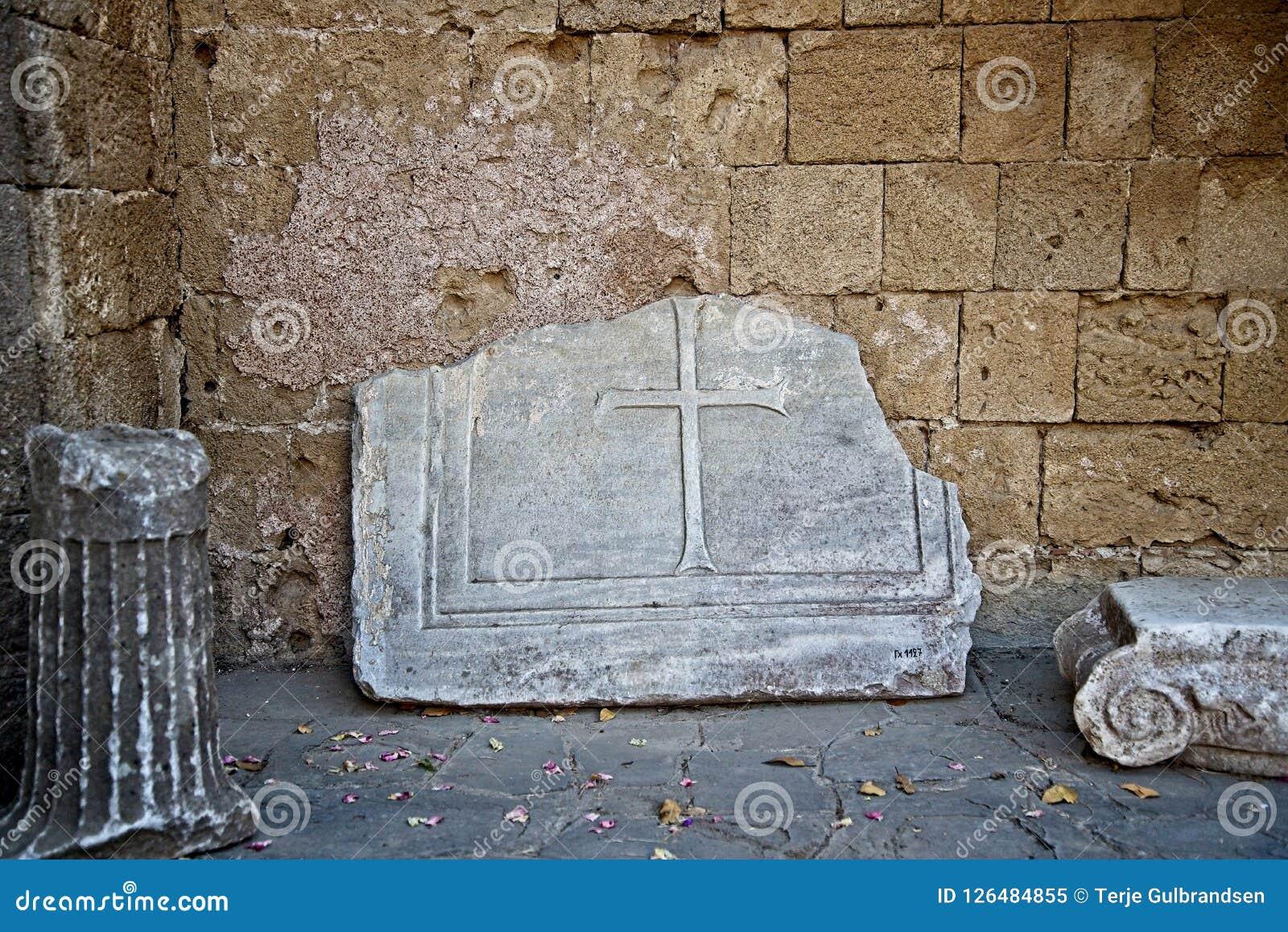 Broken stone cross found in Acropolis of Ialysos near the temple.