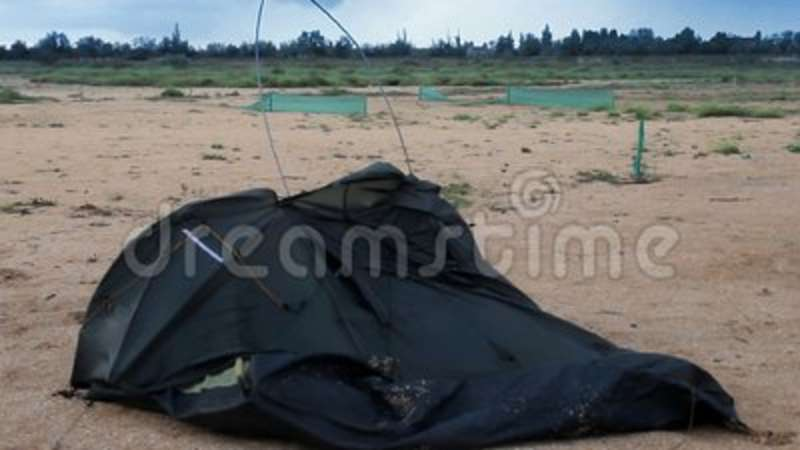 & Broken tent at the beach stock footage. Image of beach - 101349400