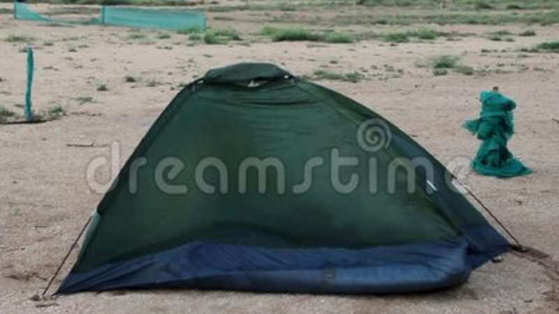 & Broken tent at the beach stock video. Image of shelter - 101334449