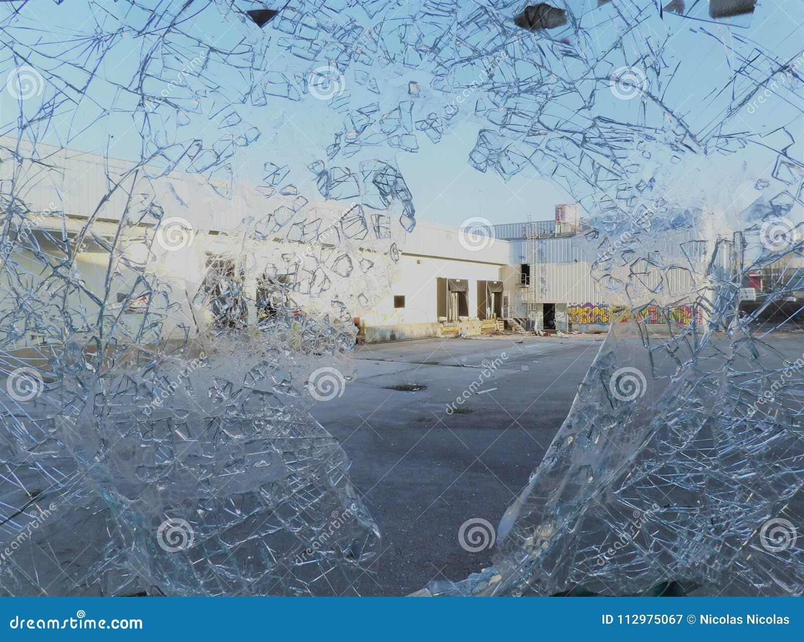 Broken window disused factory